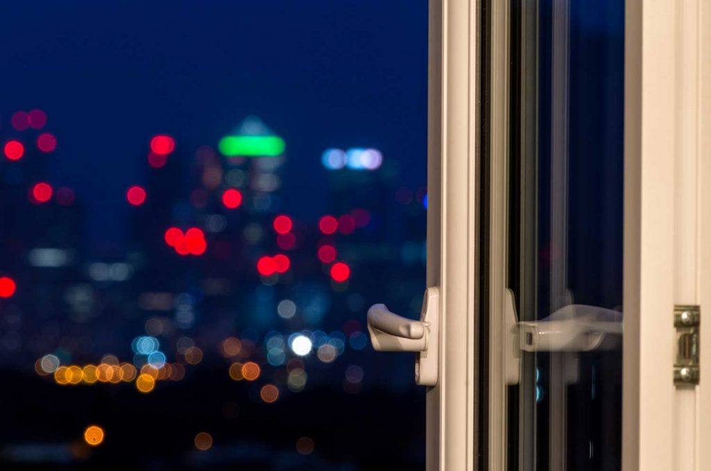View of blurred city lights from an open window