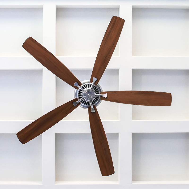 A close up photo of a ceiling fan with wooden blades