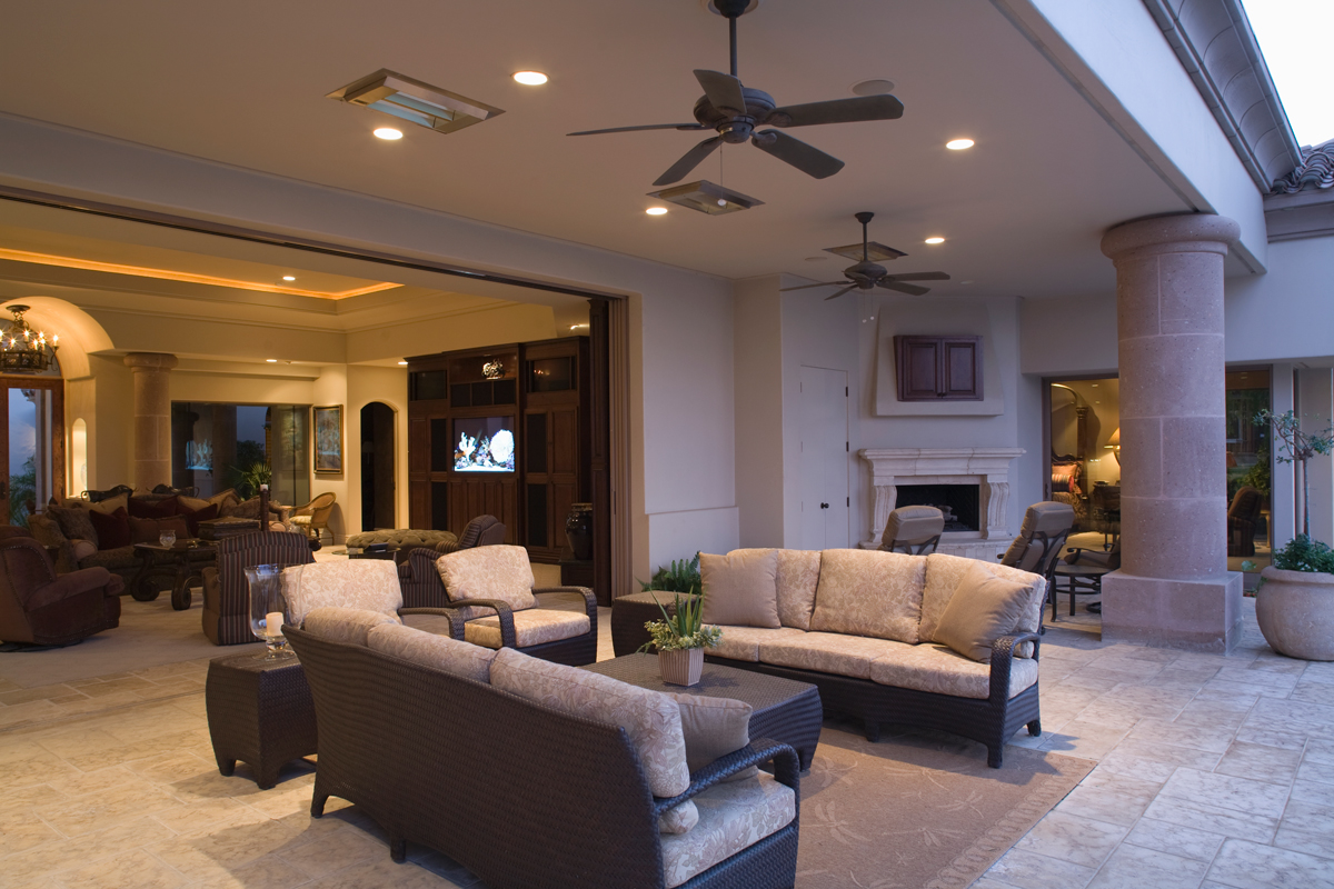 A luxurious mansion packed with expensive furnitures and a properly lit entertainment area and black ceiling fans for ventilation