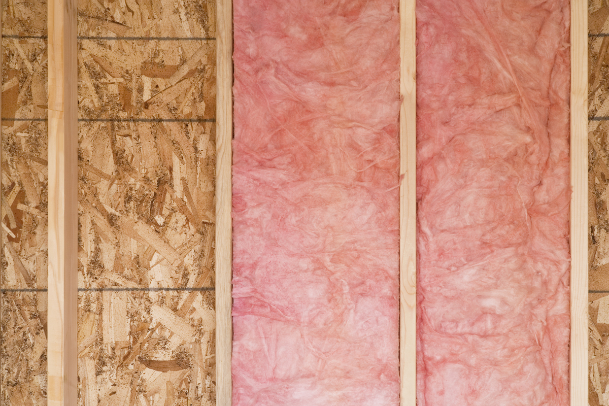 A newly constructed wall with fiberglass insulation