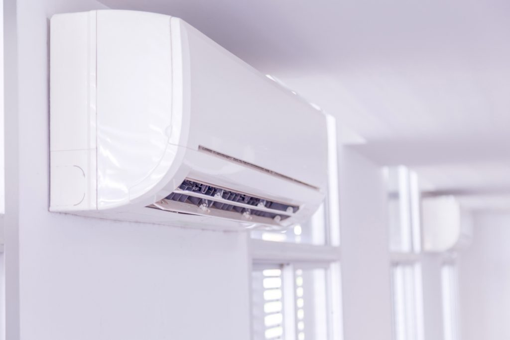 A split type air conditioner on a white wall