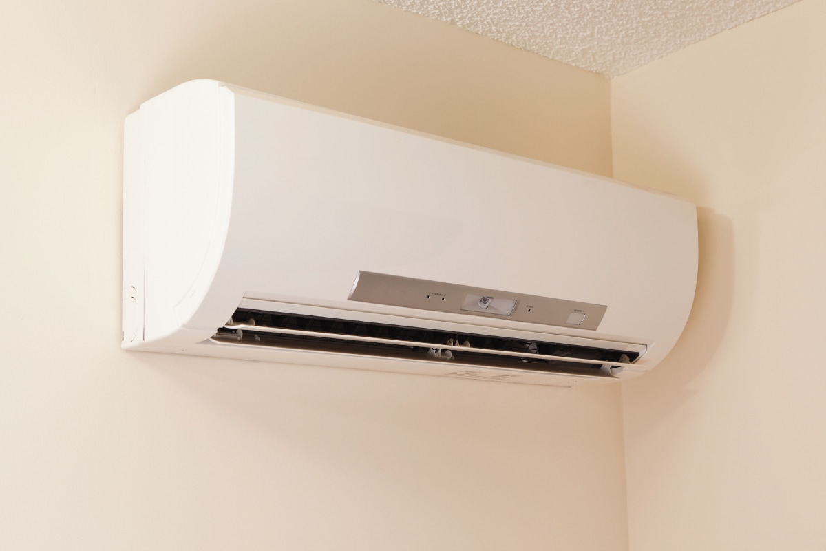 A wall-mount mini-split heating and air conditioning unit installed in a new house