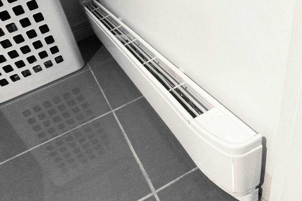 A wall mounted electric convection heater
