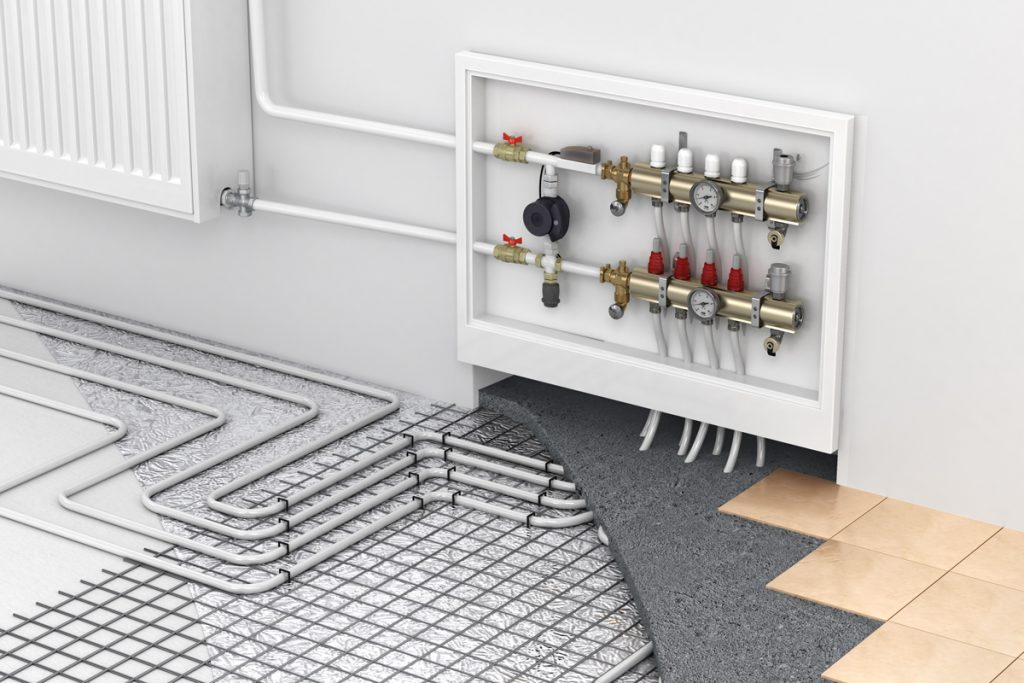 An underfloor heating system with a collector and radiator panel on the side