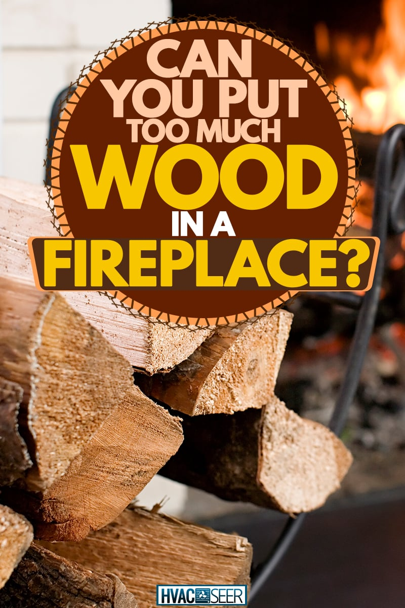 A close up photo of chopped firewood next to a fireplace, Can You Put Too Much Wood In A Fireplace?