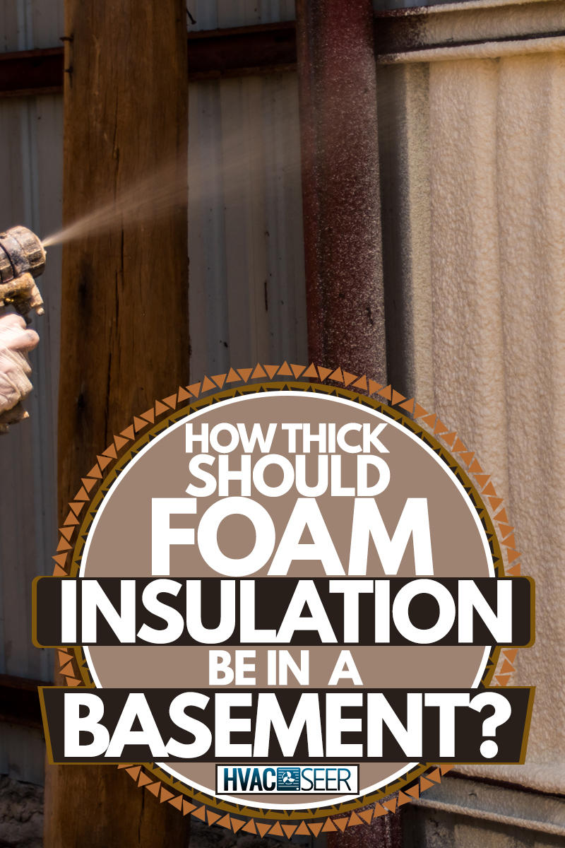 An insulation specialist spraying insulation foam on the walls, How Thick Should Foam Insulation Be In A Basement?