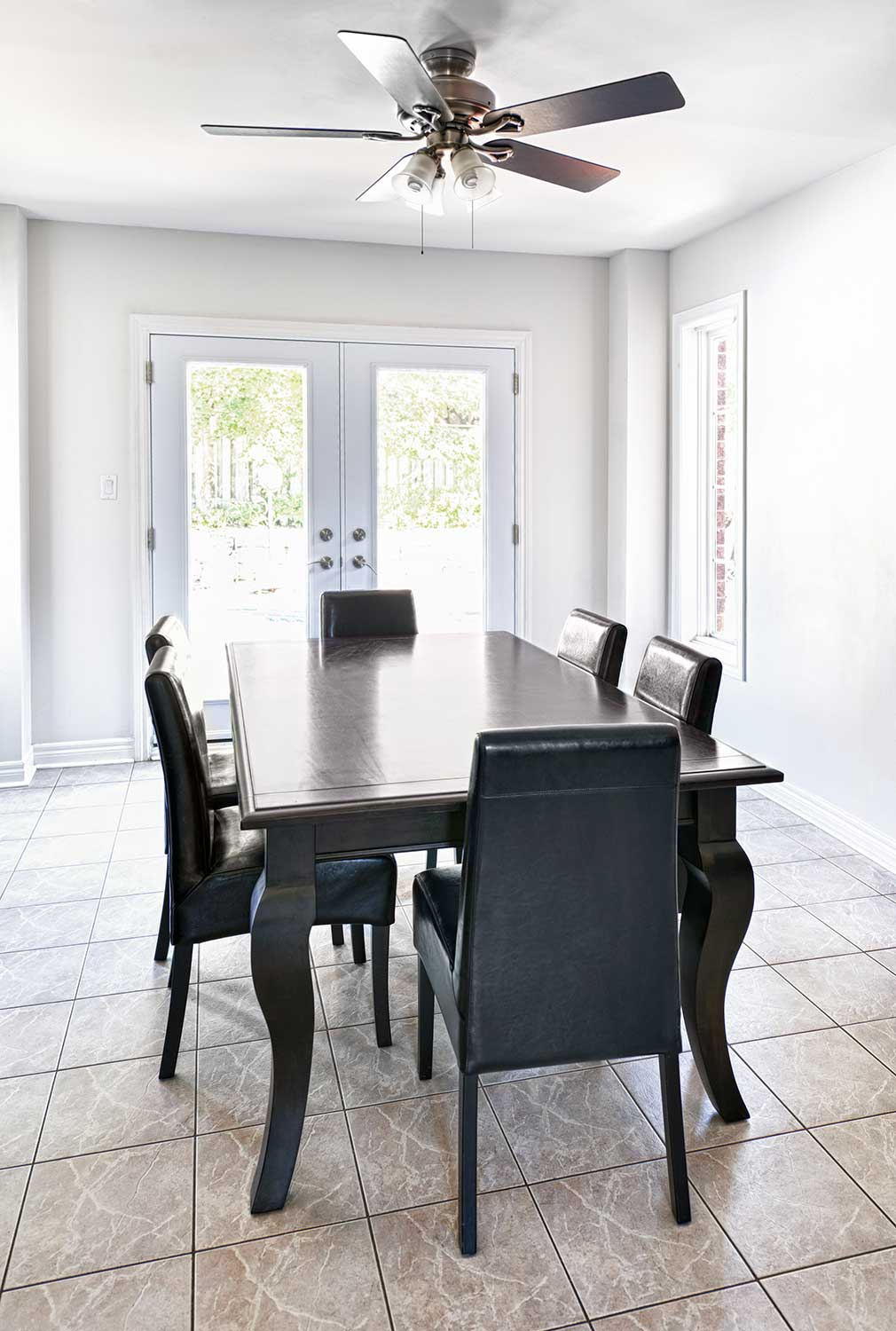 Interior with dining table and ceiling fan