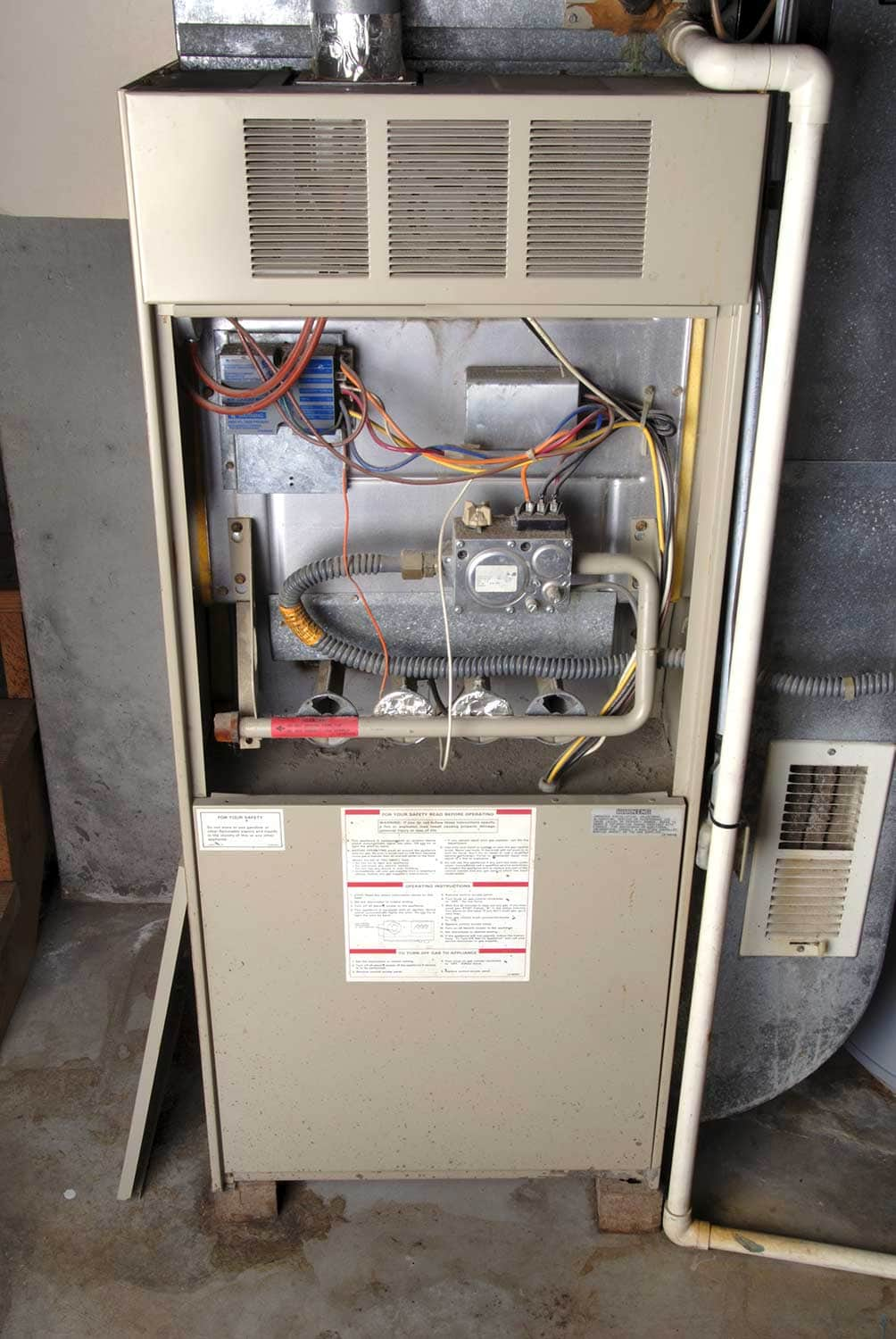 Natural-gas furnace in a typical basement installation of a home