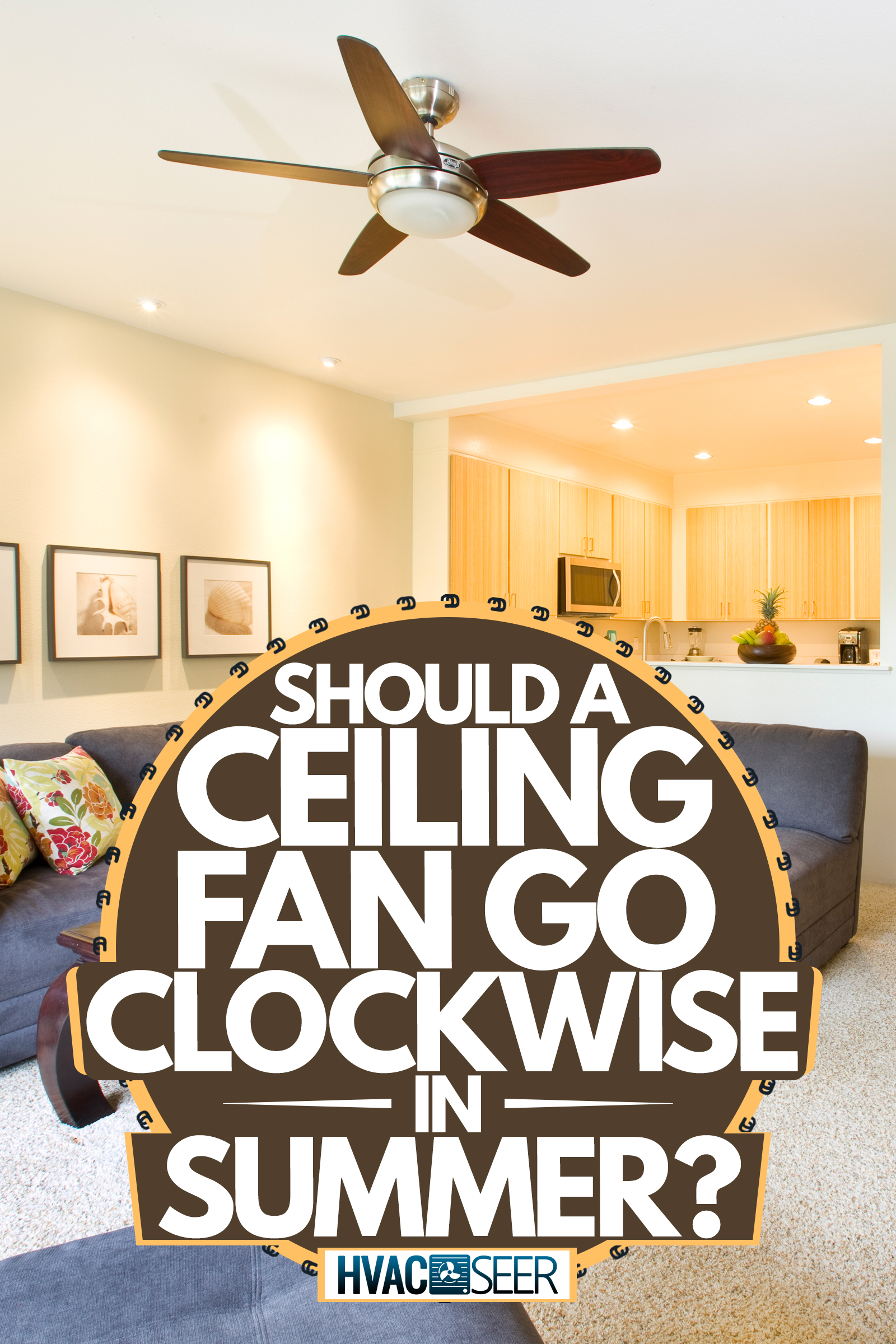 A classic tropical beach themed living room with white painted walls, gray couches, and a ceiling fan with wooden blades, Should A Ceiling Fan Go Clockwise In Summer?