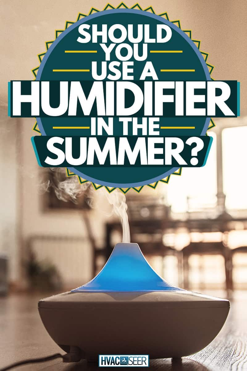 An Air Humidifier with placed on a wooden floor near the dining area, Should You Use A Humidifier In The Summer?