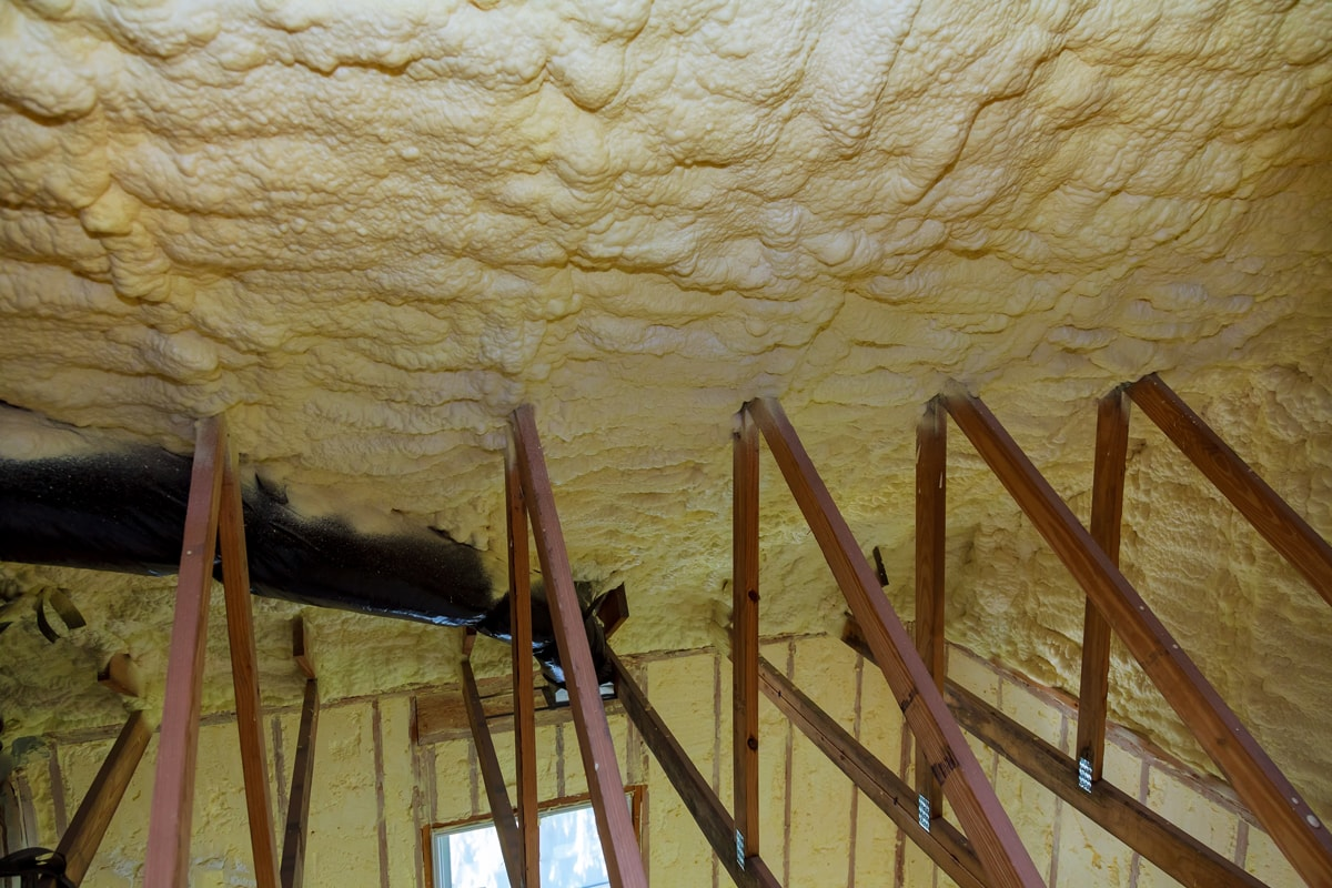 Solidified foam for thermal insulation on an attic