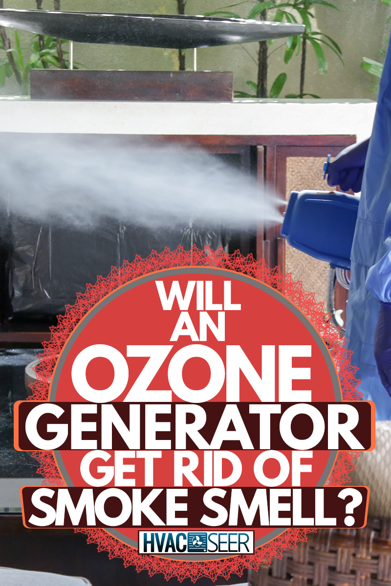 A man spraying gas ozone inside his house while wearing a PPE, Will an Ozone Generator Get Rid of Smoke Smell?