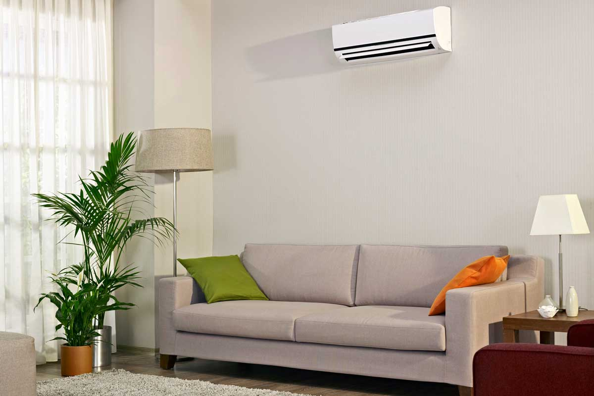living room of a modern house, with split type air conditioner and radiant floor heating, How To Cool A House With Radiant Floor Heating