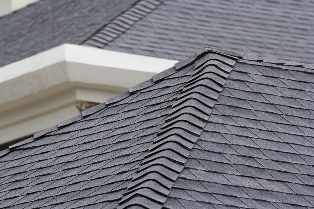 A detailed photo of an asphalt roofing of a mansion