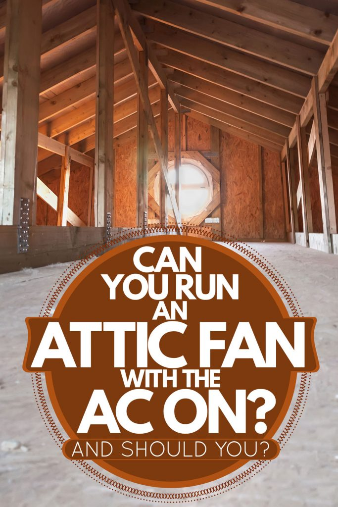 An attic with wooden frame roof membranes with an attic skylight with fan, Can You Run An Attic Fan With The AC On? [And should you?]
