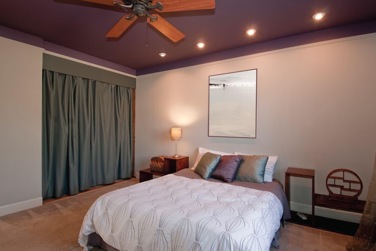 modern bedroom with wooden ceiling fan