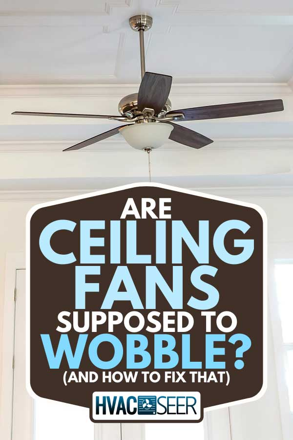 A white tray ceiling fan in small new construction house, Are Ceiling Fans Supposed To Wobble? (And How To Fix That)
