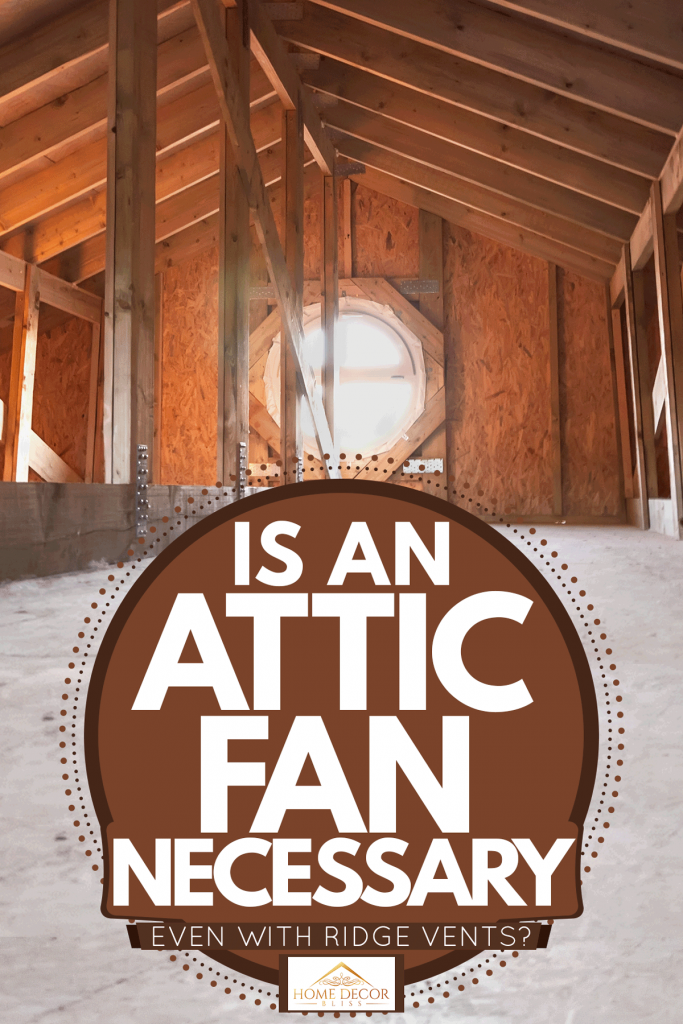 An attic of a house with visible wood membranes and an attic fan, Is An Attic Fan Necessary (Even With Ridge Vents)?