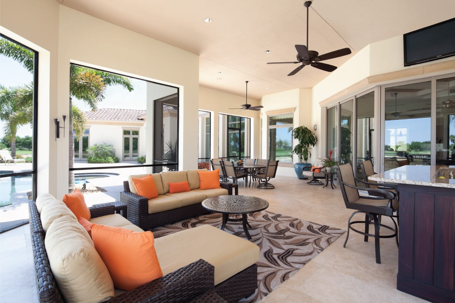 lanai living large windows with two ceiling fans