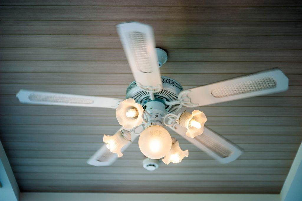 An up close photo of a ceiling fan inside a living room