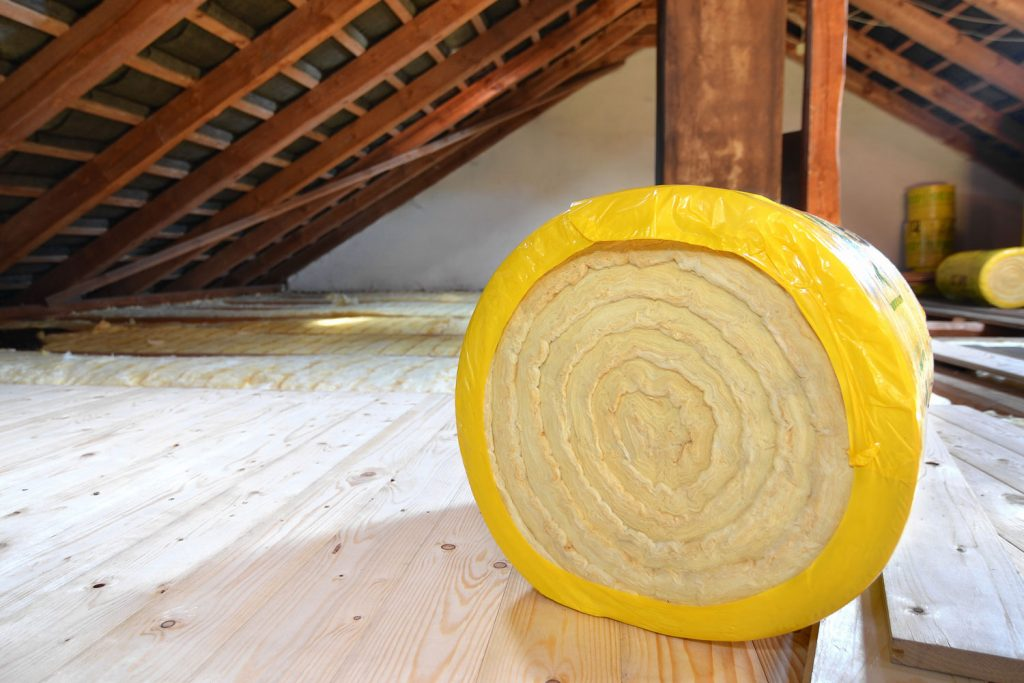 Rolled thermal insulation for a house attic