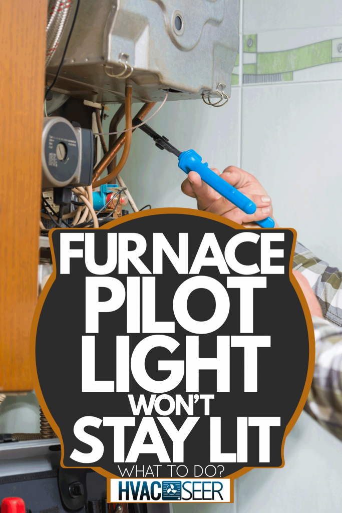 A technician lighting a gas furnace, Furnace Pilot Light Won't Stay Lit - What To Do?