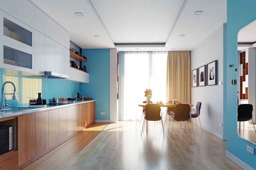 Interior of an ultra modern apartment living room with blue painted walls, wooden flooring, and a gorgeous wooden paneled cabinetry