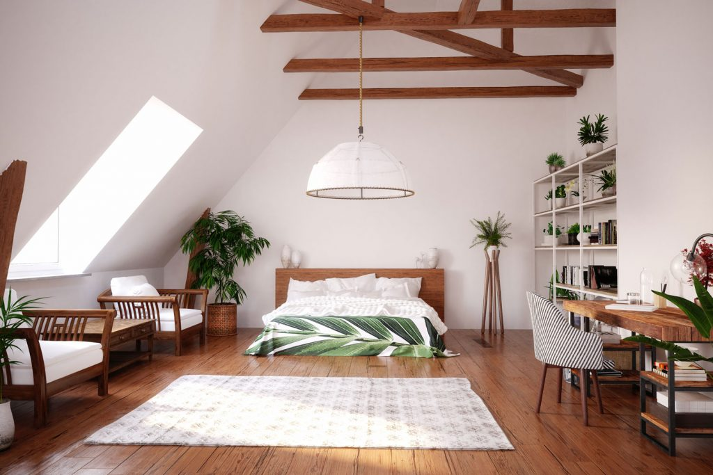 A rustic inspired attic bedroom with wooden flooring, white painted walls, and indoor plants spread all over the room, Does An Attic Fan Help With Humidity?
