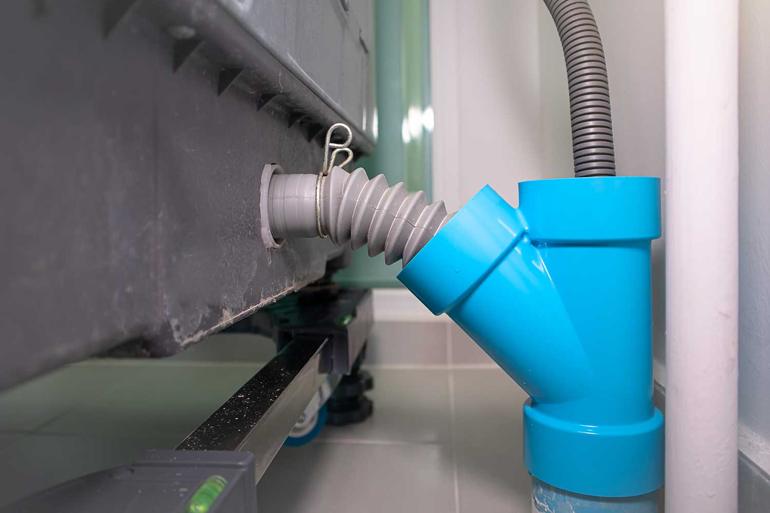 Flexible water drain pipe from washing machine and PVC pipe connector