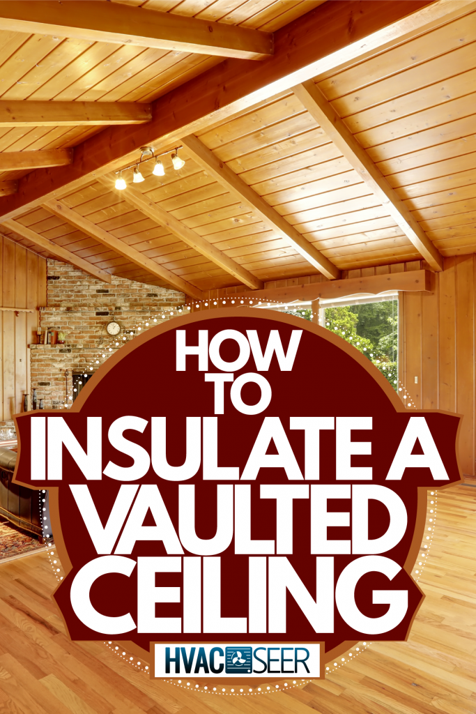 A cozy and warm rustic log cabin with brick mantled fireplace and a huge rug under the furniture's, How To Insulate A Vaulted Ceiling