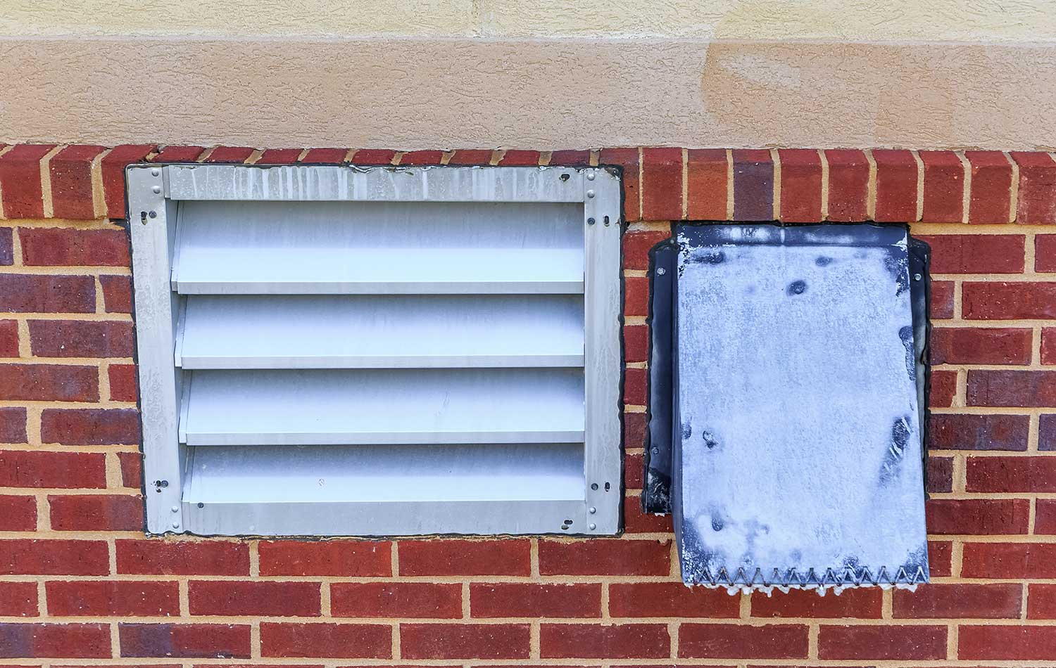 Industrial laundry room dryer vent on the back facade of a hotel