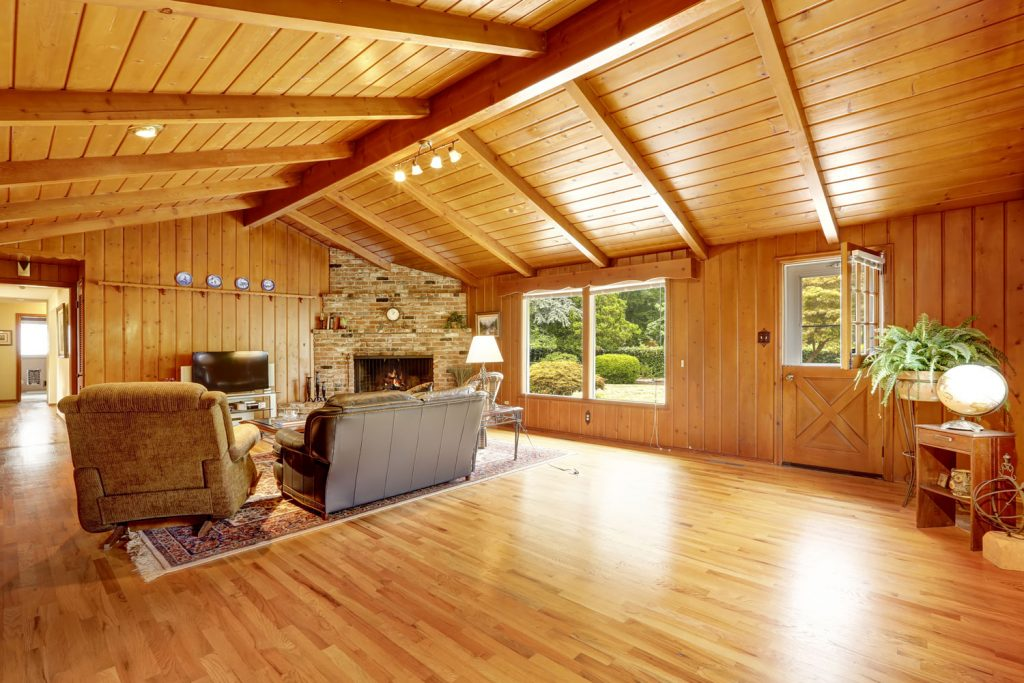 Interior of a modern rustic designed living room constructed using wood from ceiling to flooring
