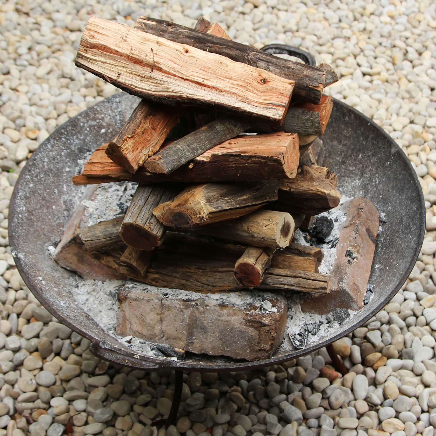 Stacked firewood inside a fire bowl