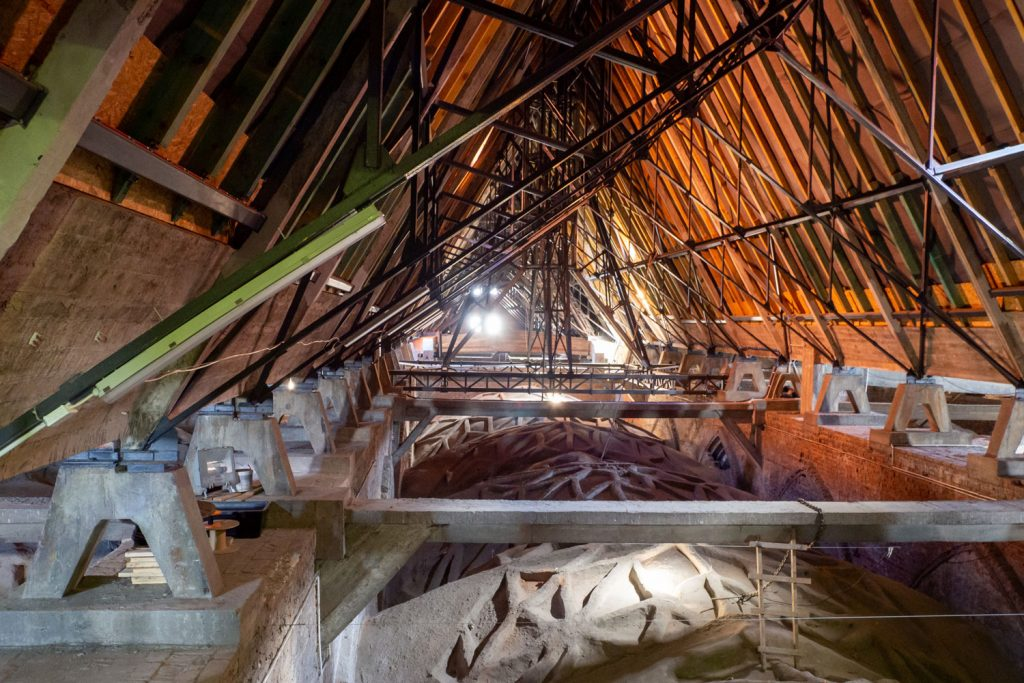The inner working of a building with vaulted ceiling