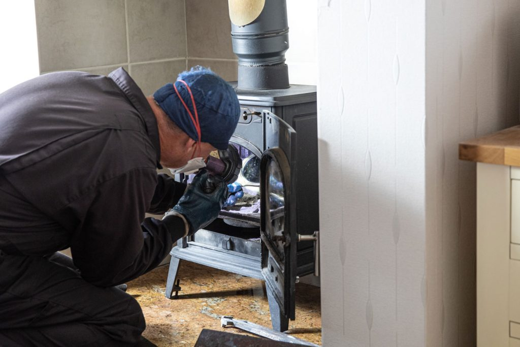 A HVAC personnel checking the gas furnace of a house