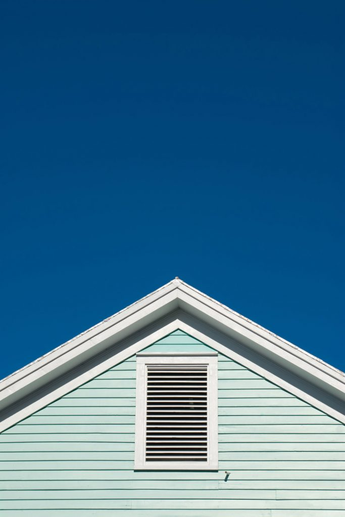 A light blue colored asymmetric gable type roofing