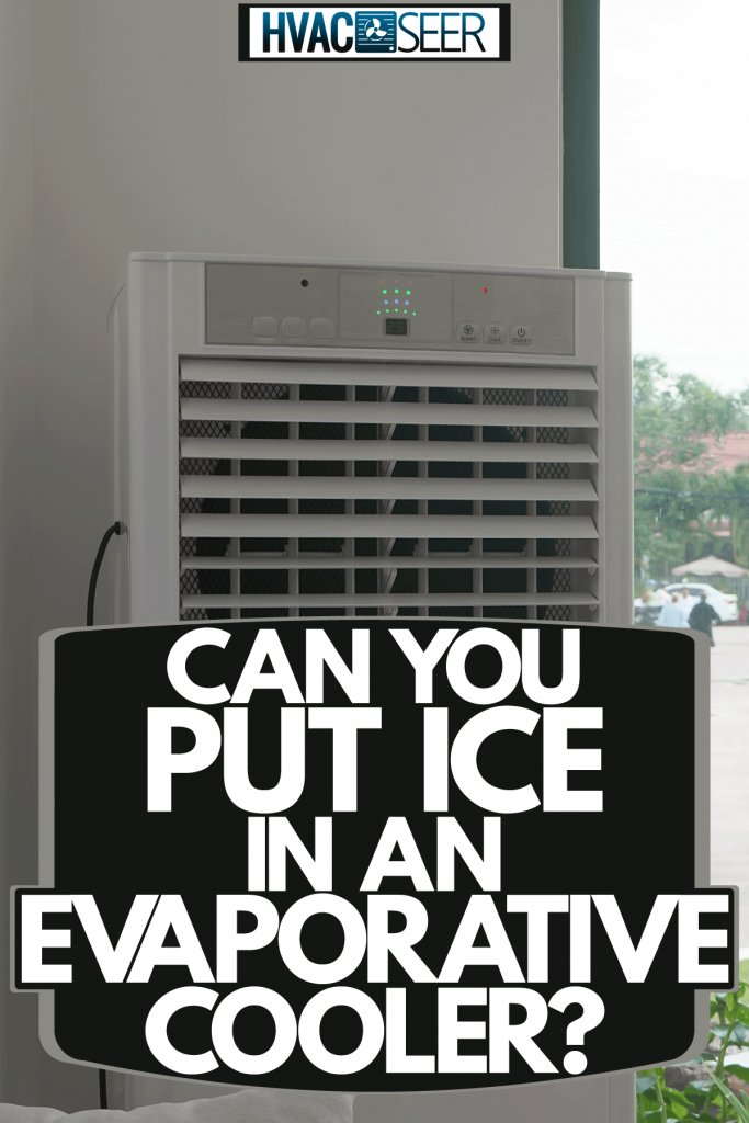 A cooler inside a living room placed next to a window for proper cooling, Can You Put Ice In An Evaporative Cooler?