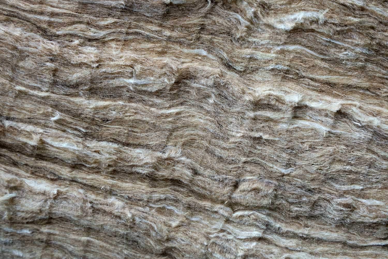 Close-up of roll of fiberglass insulation material
