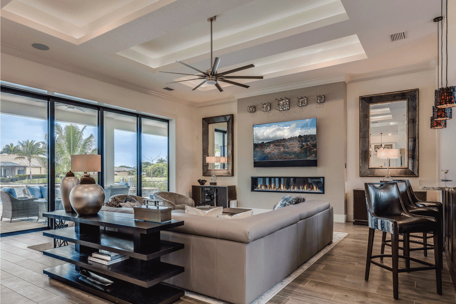 Coffered ceiling and linear fireplace give this room a luxury feel