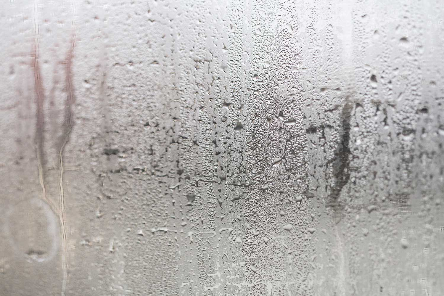 Condensation on window glass caused by high humidity in winter