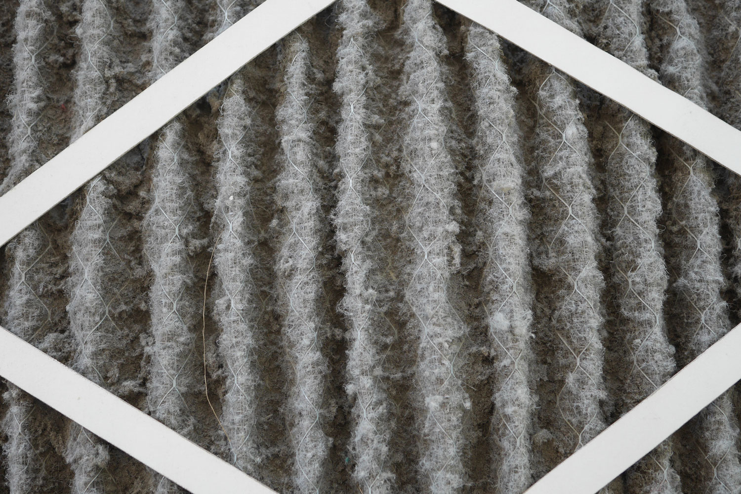 Home air filter close up macro zoom show the dirt and particle cause bacteria inflection and sickness