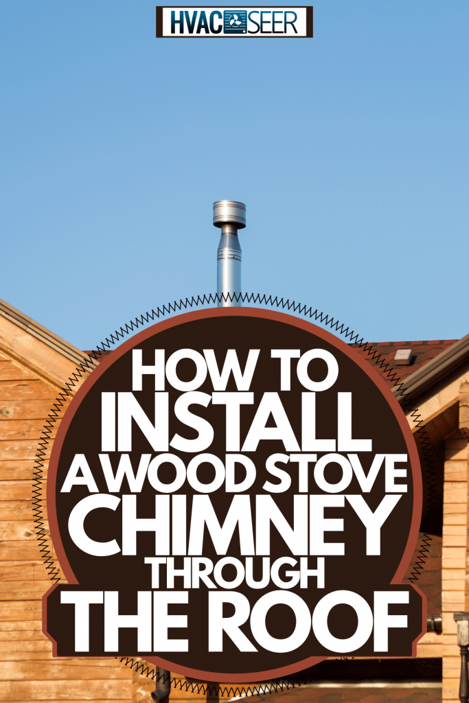 A wooden stove chimney photographed on top of a cabin house, How To Install A Wood Stove Chimney Through The Roof