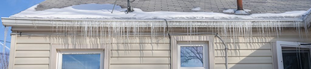 Ice damming occurring on the roof of a house