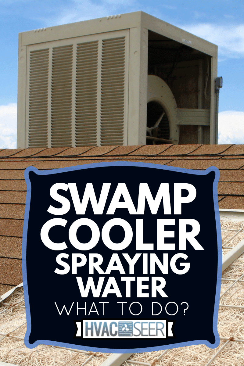 This color photo shows a swamp cooler on a reddish-orange shingled roof. One panel of the swamp cooler has been removed and placed in the foreground to show the pad or filter made of aspen wood, Swamp Cooler Spraying Water - What To Do?