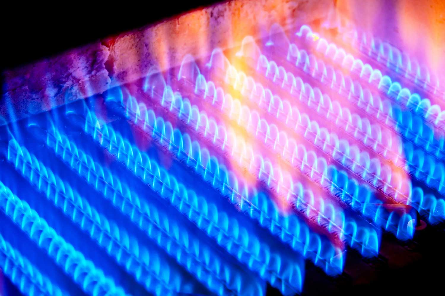The fire burns from a gas burner inside the boiler