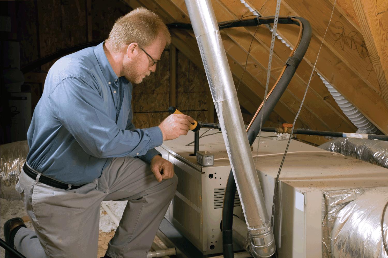 service man inspecting furnace