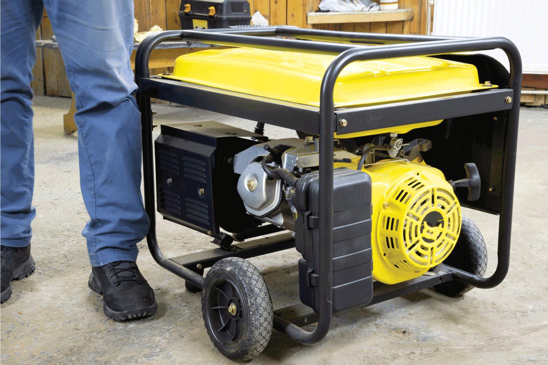 yellow Gasoline Portable Generator beside a man