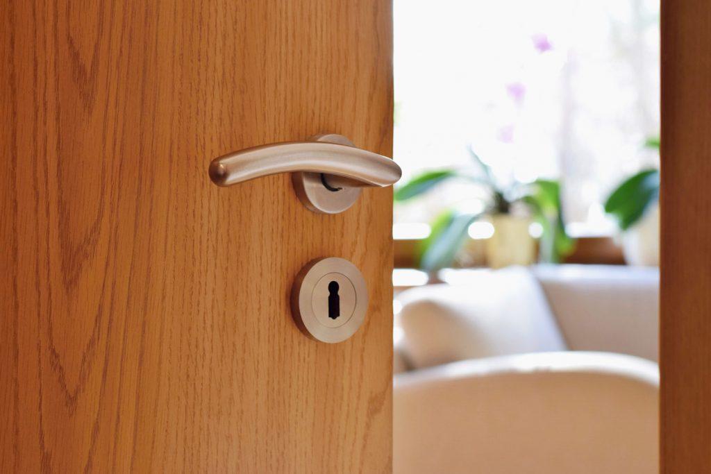 A wooden door with a modern door handle