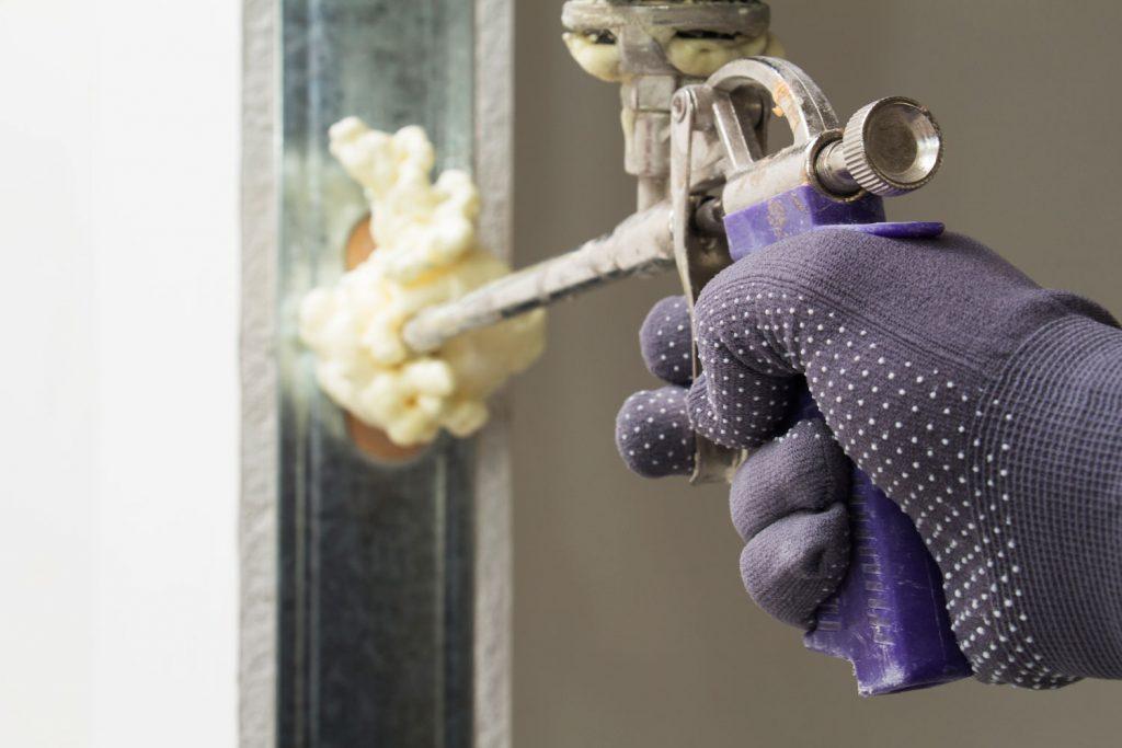A worker fixing the front door knob