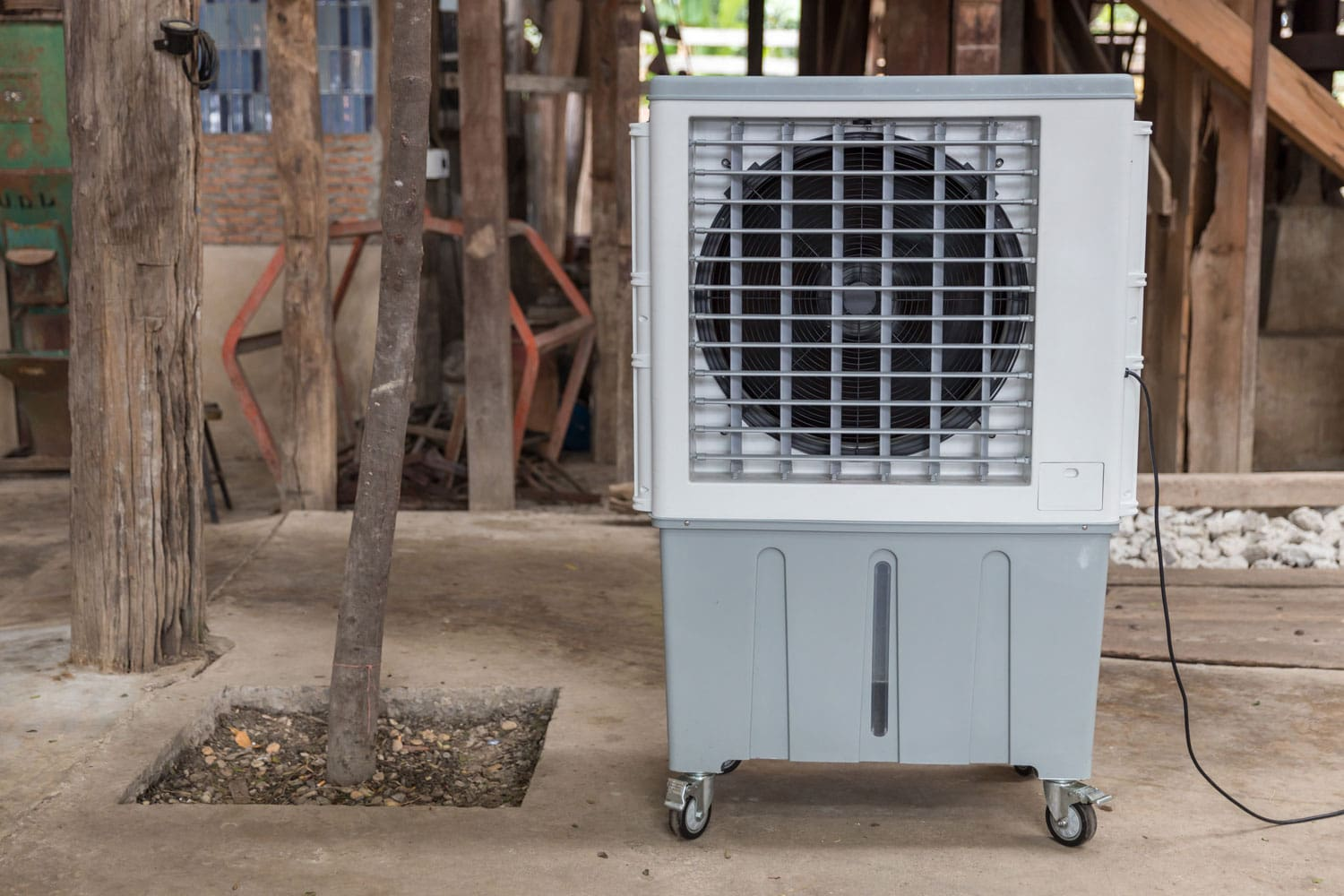 An evaporative air cooler placed on the side of a house, 14 Types Of Evaporative Cooler And Brands To Know